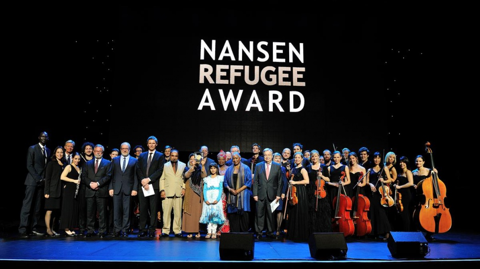 Afghan refugee and educator, Aqeela Asifi, accepts the 2015 Nansen Refugee Award in Geneva, Switzerland.