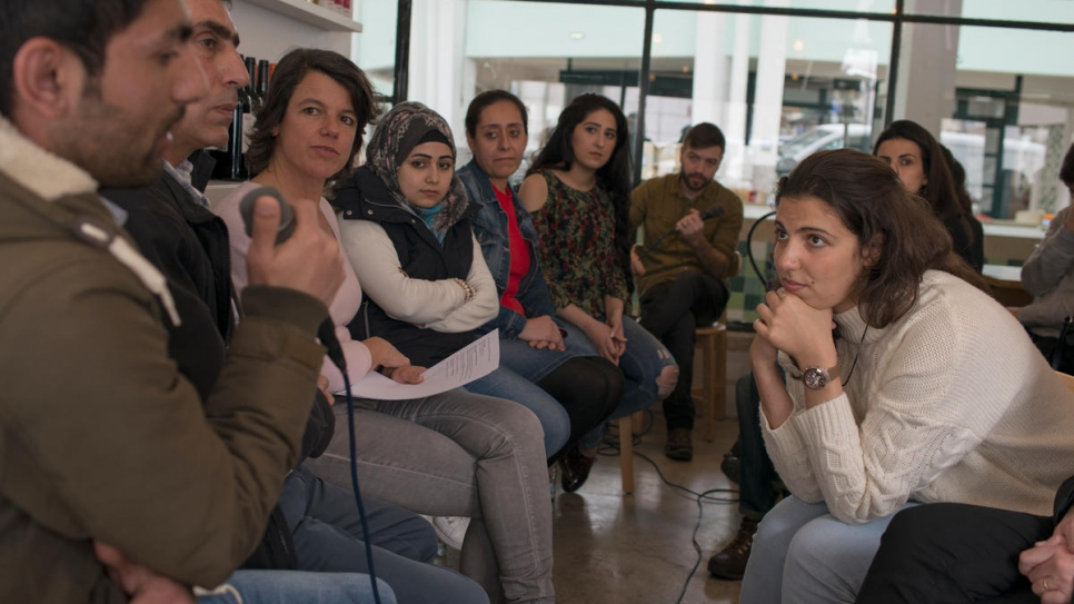 At a discussion evening in Lisbon's Mezze restaurant, Syrian newcomers answer questions from the Portuguese public.