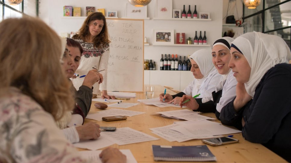 Between shifts, Mezze chefs Fatima and her two daughters, Rana and Reem, from Syria, sit down with other staff to improve their Portuguese.