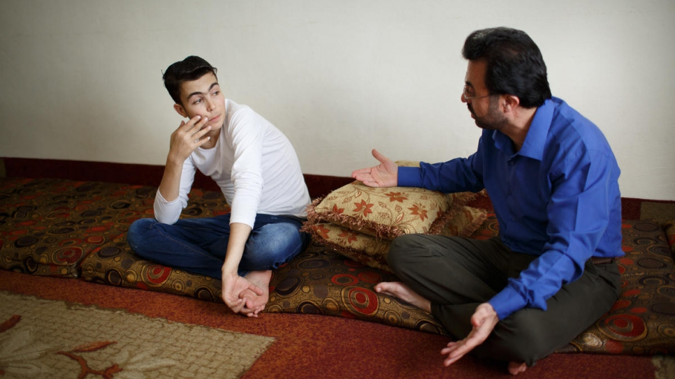 Ahmad Mifleh (left) talks to his father Hamed at their home in Madaba, Jordan, where they have lived since fleeing their hometown of Dara'a in southern Syria in 2013.