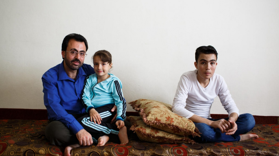 Hamed Mifleh (left) with his children Bara'a, 7, and Ahmad, 21, both of whom suffer from thalassaemia, a blood disorder that requires regular transfusions and costly medication.