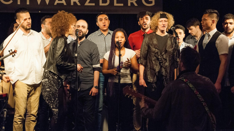 Refugees and music students take part in the first joint concert at the Schwarzberg music pub in Vienna.