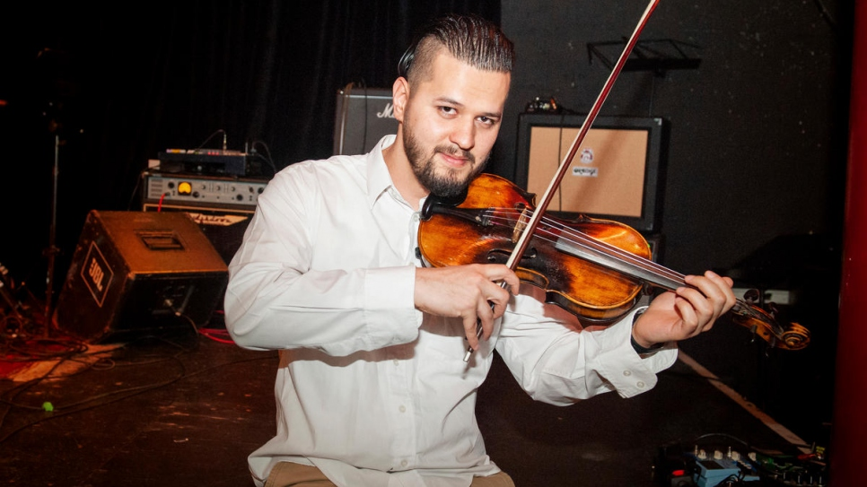 The project has allowed Said Ahmad Hoseini, 23, from Afghanistan to realize his dream of learning the violin.
