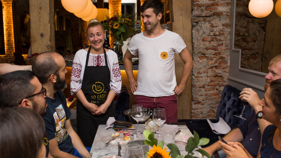 Refugee chef Natalia from Ukraine meets diners at Restaurante Gigi in Madrid.