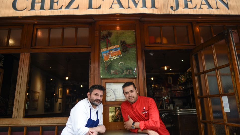 Syrian refugee chef Mohammad with local chef at L'Ami Jean in Paris, 2016.