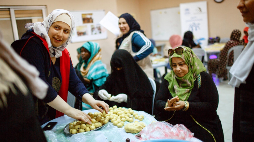 A group of refugee women from Iraq, Yemen, Syria and Sudan as well as Jordanian residents make ma'moul, an Arabic sweet for Eiid. The sweets will be distributed to needy families, refugees and Jordanians, in Amman, Jordan.