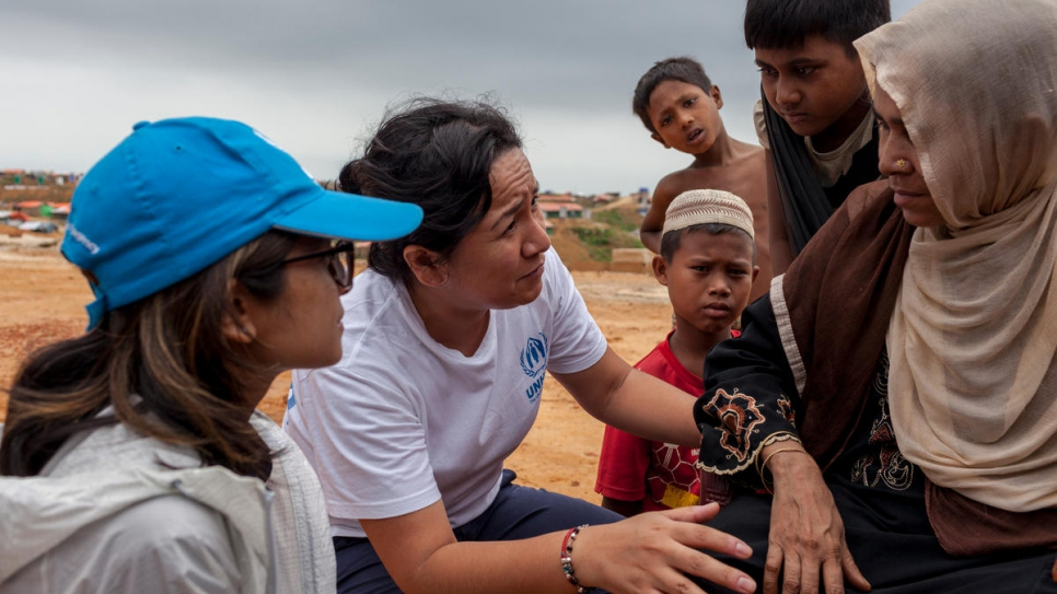UNHCR workers Sarah Jabin (left) and Jacqueline Julca (right) help to relocate refugees in Bangladesh.