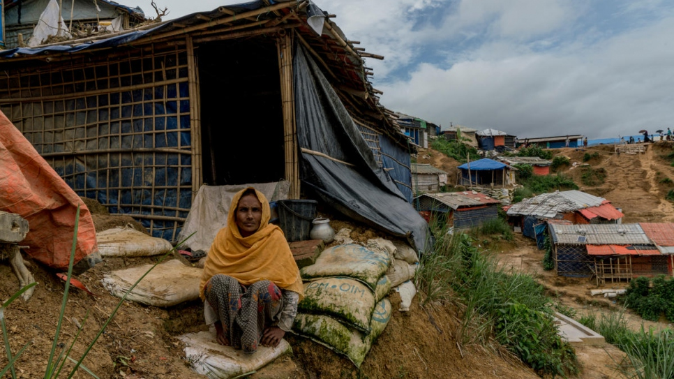 Ayesha Begum, 45, worries that her home on a steep hillside is at risk of landslides as the monsoon season bears down on Kutapalong refugee settlement near Cox's Bazar, Bangladesh.