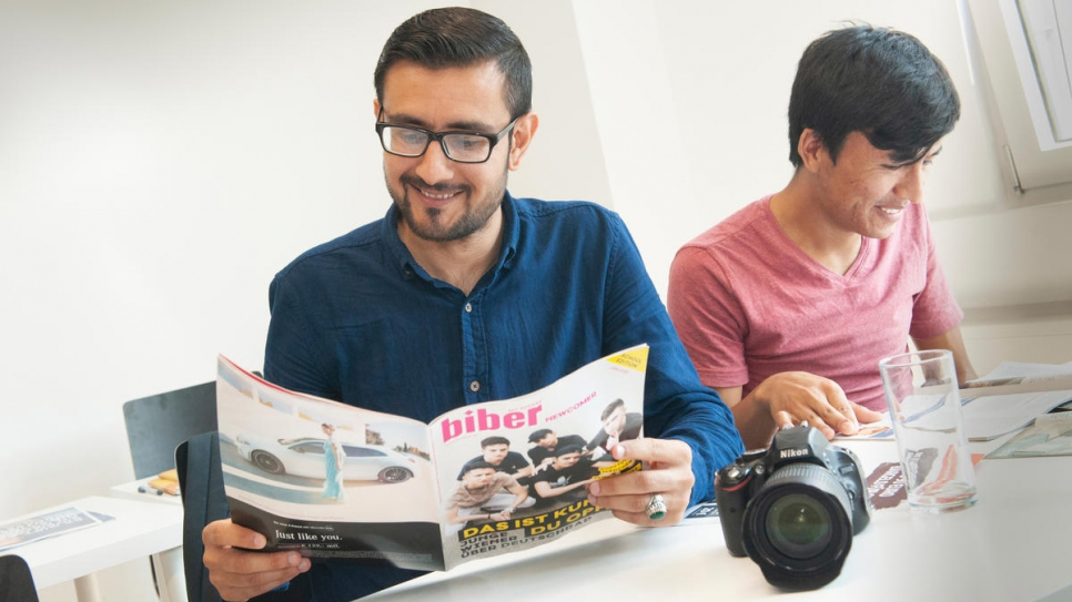 Murtaza Elham (left) and Rohullah Anifi, both from Afghanistan, read Biber magazine on the media training course.