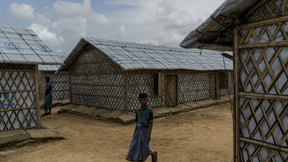 A young Rohingya refugee explores the new Camp 4 Extension after being relocated.