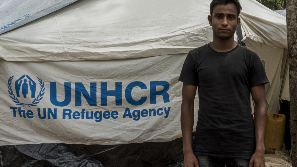 Mohammad Rafique, 20, a Rohingya refugee who fled Myanmar 40 days ago stands outside his tent in the UNHCR transit centre near Kutupalong refugee camp in Bangladesh.