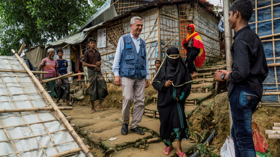 High Commissioner for Refugees, Filippo Grandi (center) meets Rohingya refugees as he walks around Chakmarkul camp, Bangladesh on July 3rd, 2018.