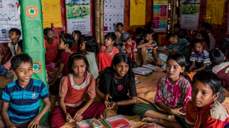 Rohingya refugee children in a learning centre in Kutupalong camp 4 are visited by High Commissioner for Refugees, Filippo Grandi (unseen) in Kutupalong camp 4, Bangladesh on July 3rd, 2018.