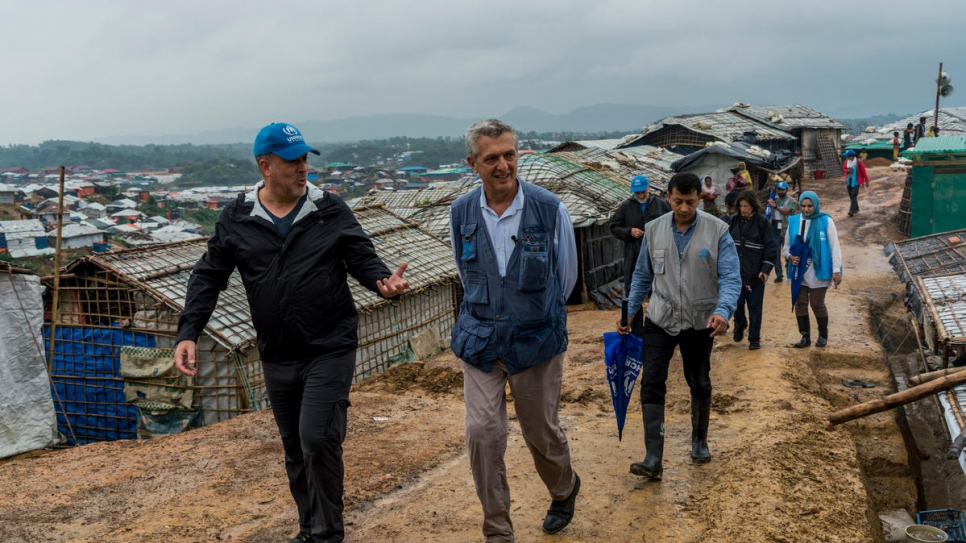 High Commissioner for Refugees, Filippo Grandi (right) is briefed by a UNHCR colleague as he walks around Kutupalong camp 4, Bangladesh on July 3rd, 2018.