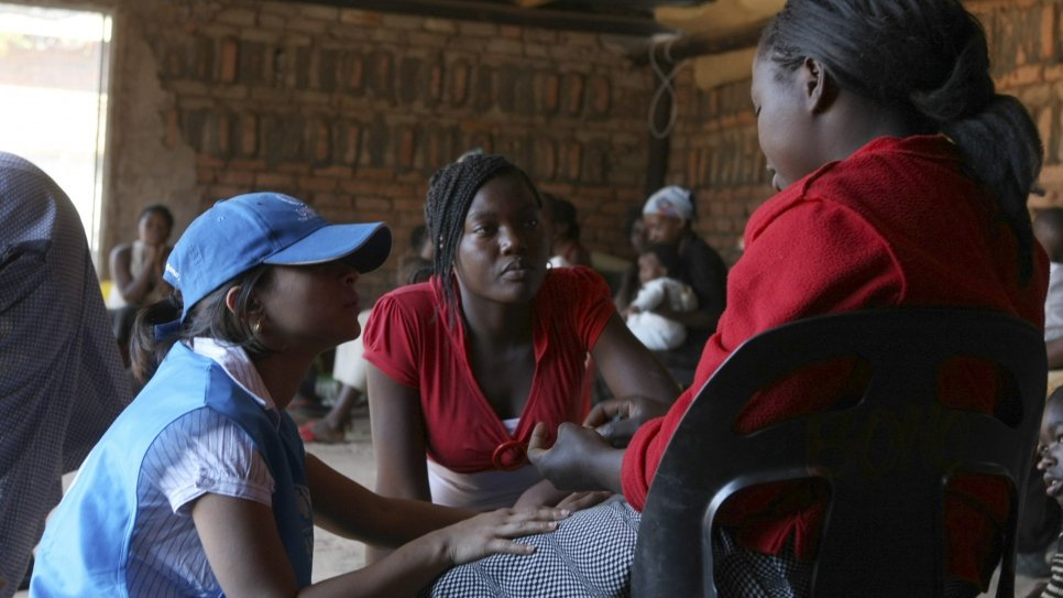 UNHCR Protection Officer Kamini Karlekar and Julieth Gudo (shelter staff) speak to women and children at the United Reformed Church's shelter for Gender Based Violence in Nancefield Musina. The shelter houses women and children who have undergone trauma on their journey from Zimbabwe. Many refugees were robbed and some were even raped during their flight to safety.