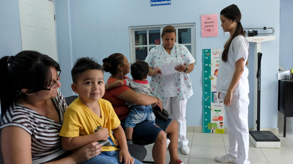 Local residents visit the medical clinic at the UNHCR-backed Holy Trinity Comprehensive Support Centre in Chamalecón, San Pedro Sula, Honduras.