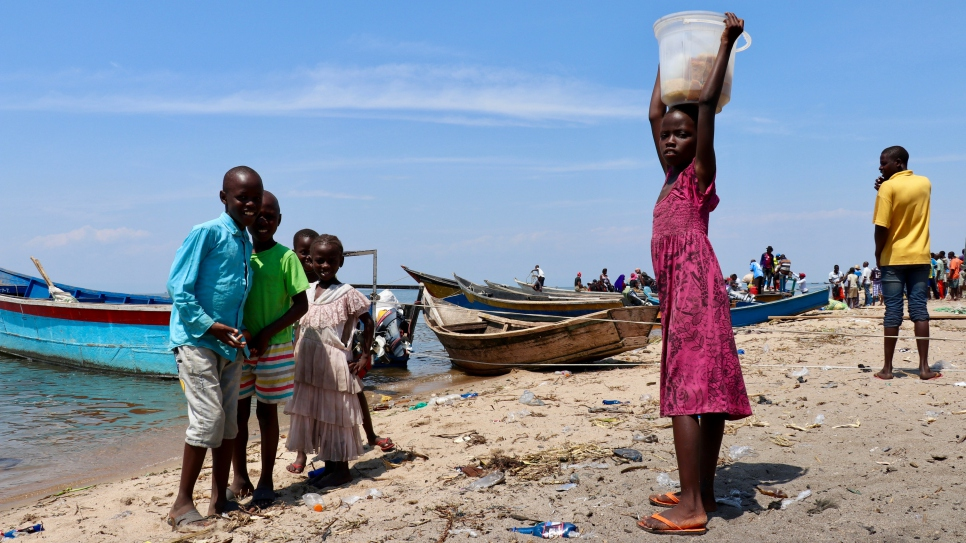 Children play on the shores of Lake Albert in Tchomia, Ituri province, where thousands of Congolese refugees who fled to Uganda have returned.