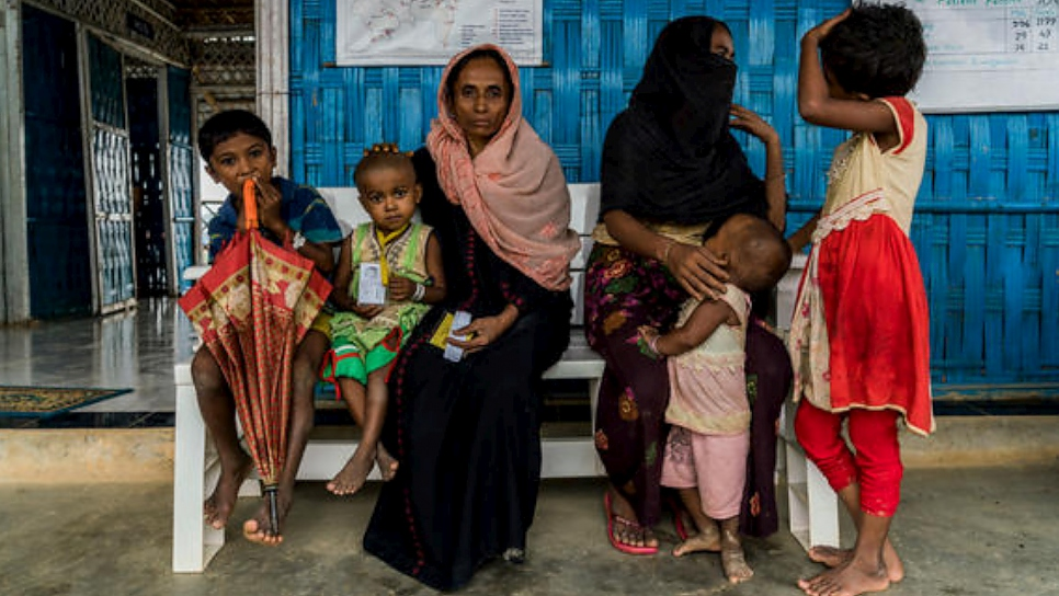 Rohingya refugee patients wait to be seen by a nurse at an integrated primary health clinic supported by UNHCR at Kutupalong refugee settlement in Bangladesh.