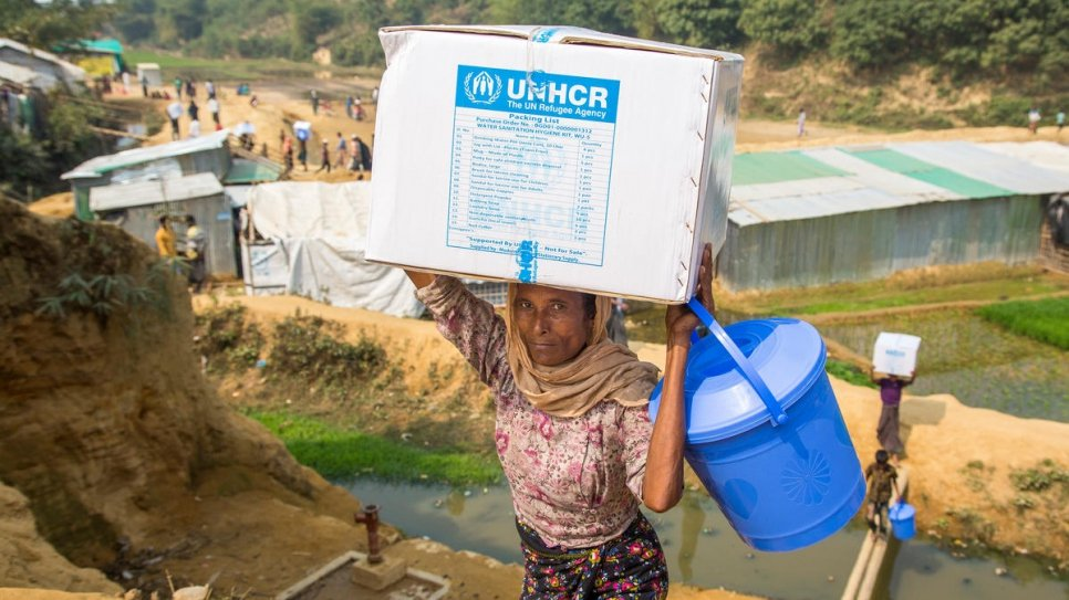 UNHCR distributes water sanitation and hygiene kits to refugee families in Kutupalong refugee settlement and Chakmakrul, Bangladesh.