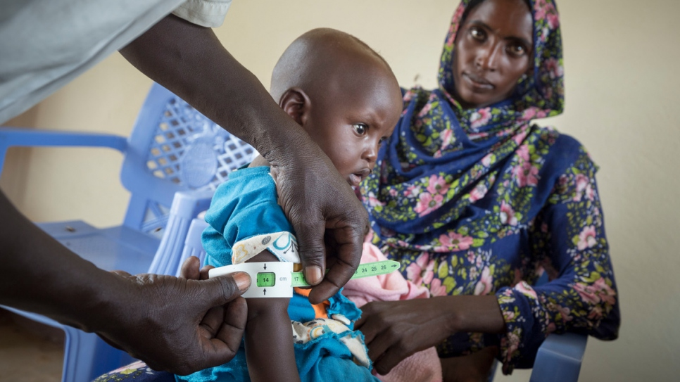 Mouna Mussa, 26, and her 9-month-old son Afaf Mohamed Ali, are members of the local Sudanese host community living near Al-Nimir camp. Afaf is suffering from severe malnutrition and is being treated by the camp's doctors.