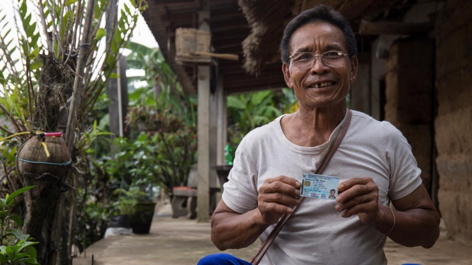 A formerly stateless man from the Lisu hill tribe shows his ID card in northern Thailand. He was supported by 2018 Nansen Award finalist for Asia, Tuenjai Deetes, in applying for citizenship.