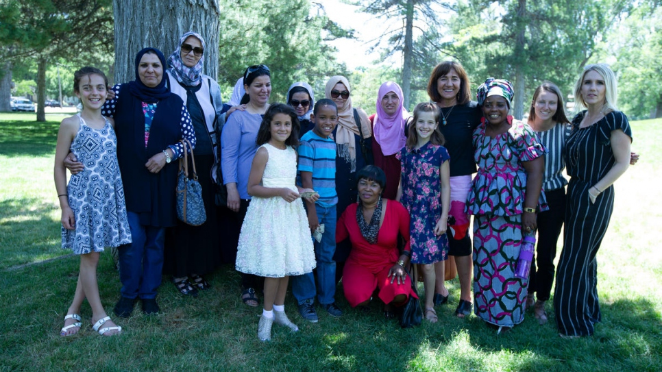Samira Harnish (fourth from right), the Americas regional finalist for the 2018 Nansen Refugee Award, with some of the participants and staff of Women of the World and their families.