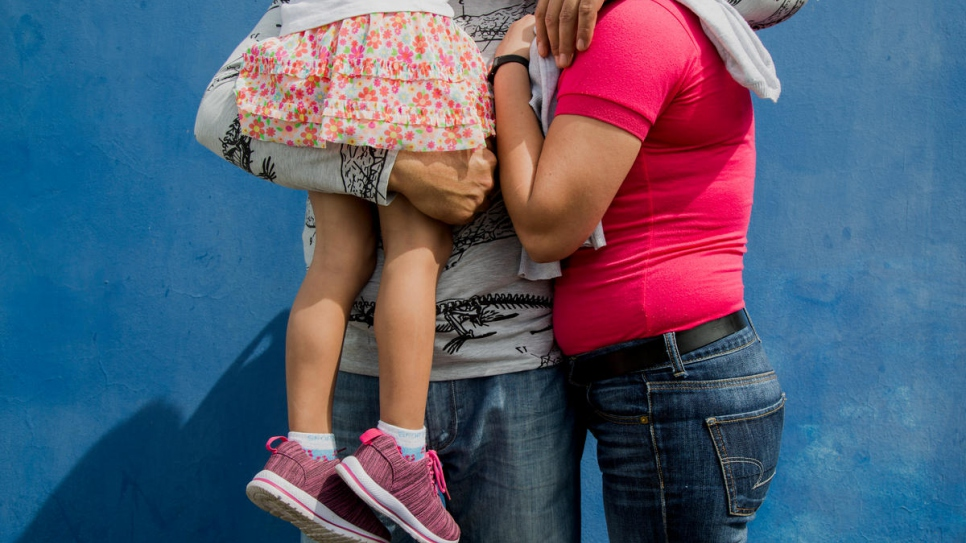 A family from Nicaragua wait to file their asylum application at the immigration office in San Jose, Costa Rica.