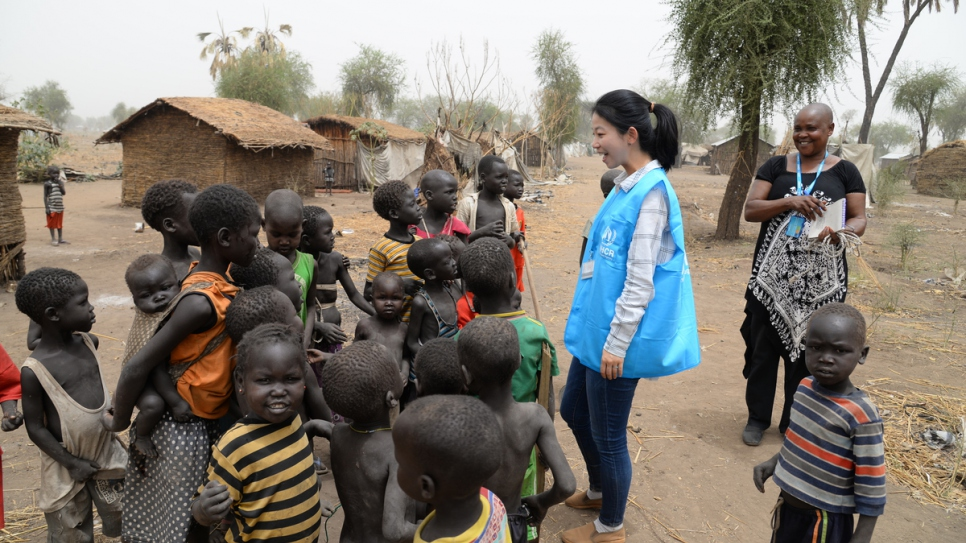 UNHCR communications officer Eujin Byun talks to refugee children at a camp in South Sudan.
