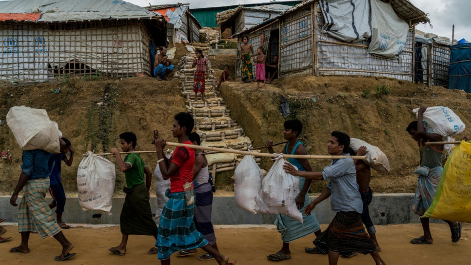 Rohingya refugees move out of an area at risk from landslides in Camp 5 to a newly built extension site in Camp 4, Kutupalong, Bangladesh.