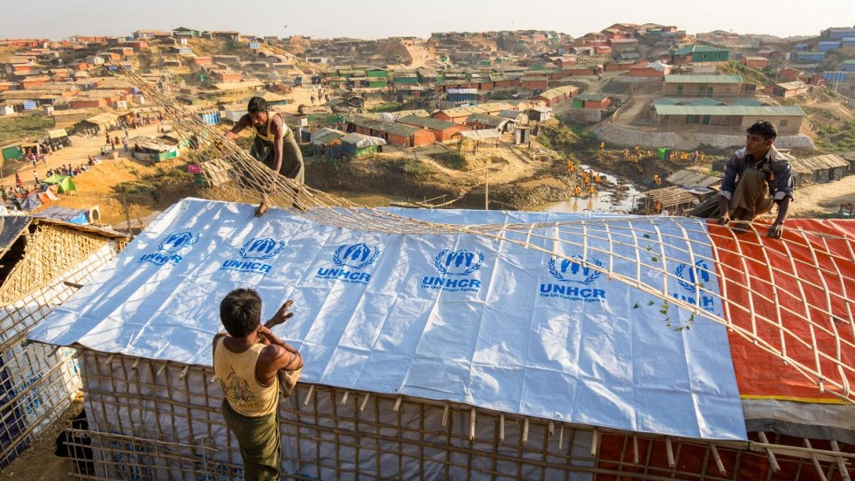 Rohingya refugees reinforce shelters with materials supplied by UNHCR at Kutupalong refugee settlement, Bangladesh.