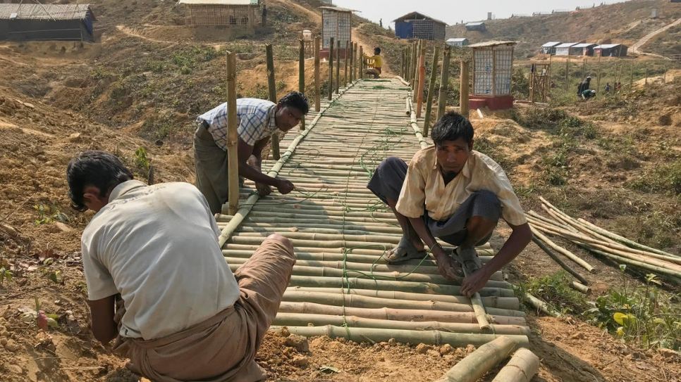 UNHCR and Rohingya refugees prepare for monsoon rains by building shelters, paths and bridges at Kutupalong camp.