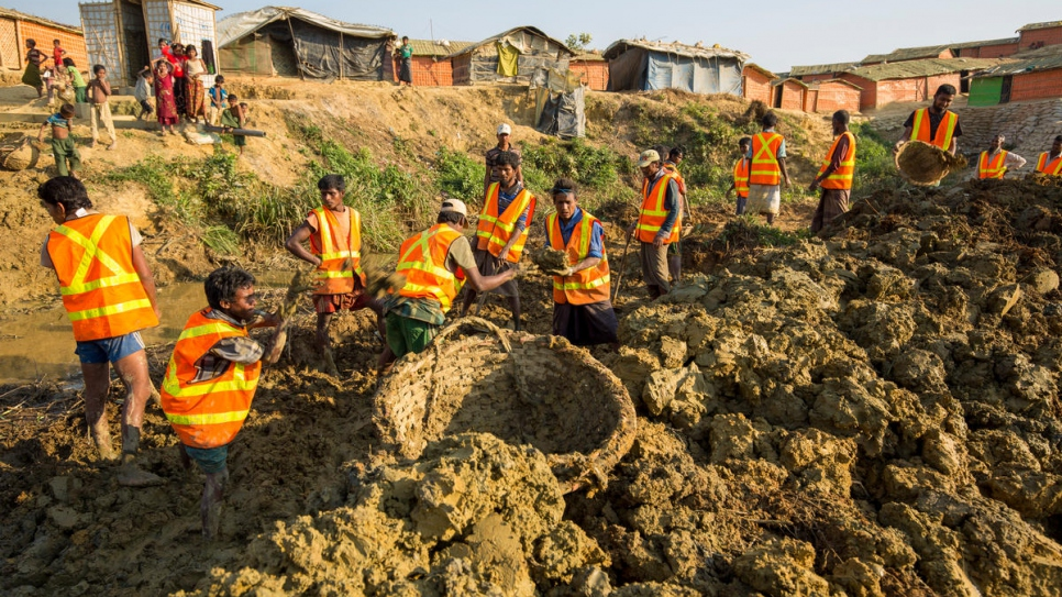 UNHCR starts work on the Site Maintenance Engineering Project, a joint initiative with the IOM and WFP to make Kutupalong camp safer for thousands of Rohingya refugees.