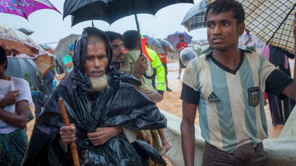 Heavy rains in Bangladesh have forced thousands of Rohingya refugees, including 60-year-old Sayedul Hoque and his family, to move into new shelters to avoid flooding.