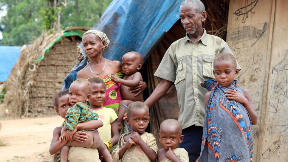 "Displaced mother Charlotte and her family at a makeshift site in Oicha. The family, who are Mbuti indigenous people, fled their lands in the so-called ""triangle of death"" in North Kivu province."