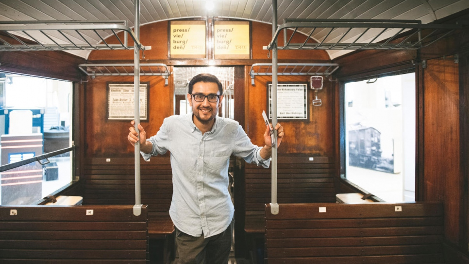 Afghan asylum-seeker Omid, 31, rides an old train at the Vienna Technical Museum.