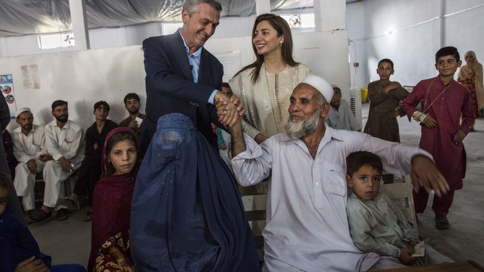 UN Refugee Chief Filippo Grandi and Mahira Khan meet with Afghan refugees who are preparing to return home to Afghanistan, at a UNHCR voluntary repatriation centre near Peshawar, Pakistan.