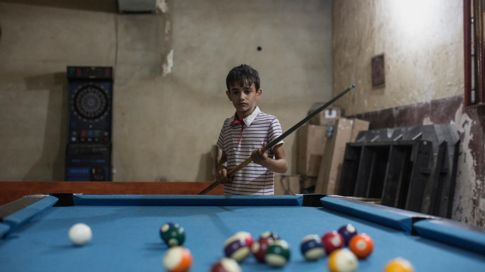 Zain plays pool in Beirut, Lebanon.