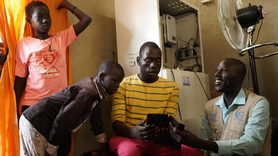 South Sudanese refugee Peter Batali runs a community initiative that helps young Ugandans access online learning platforms. Uganda allows refugees to work, start businesses and own property.