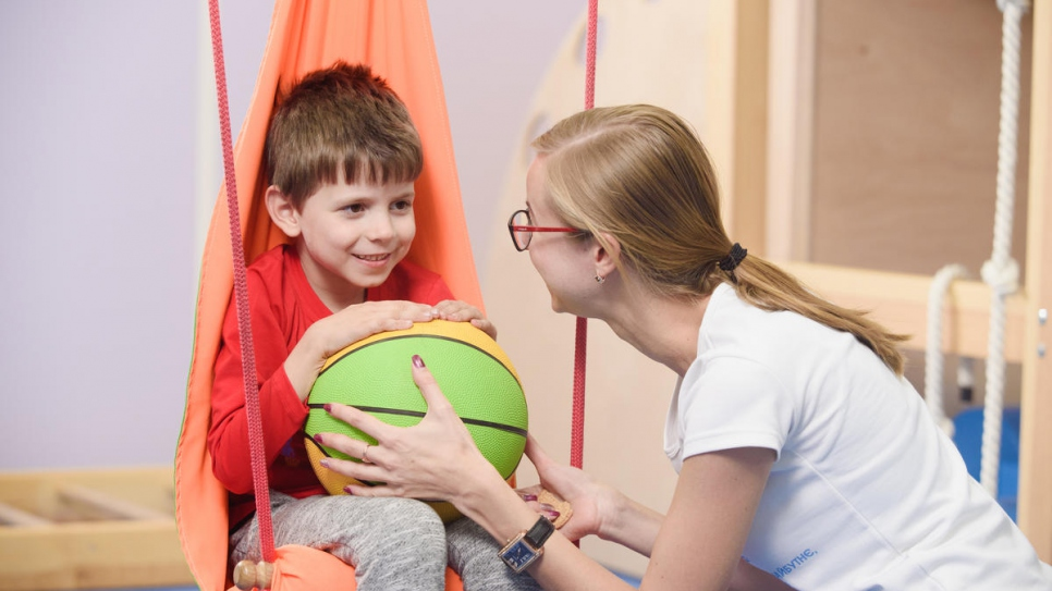 A psychologist works with six-year-old Vlad at the center.