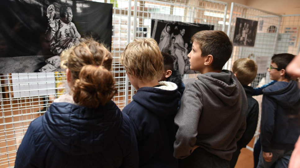 "Pupils at the Collège Octave Mirbeau in Trévières view UNHCR's photo exhibition ""The Most Important Thing"", installed at the school."