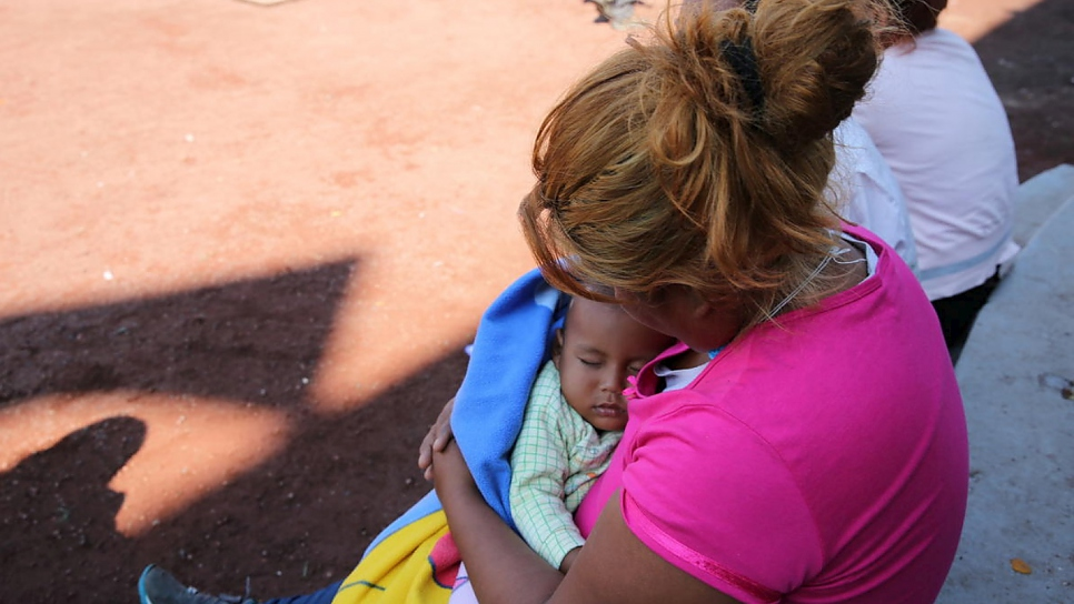 "Mitzy holds her one-year-old son Luis at a temporary shelter in the Jesús Martínez ""Palillo"" stadium in Mexico City."