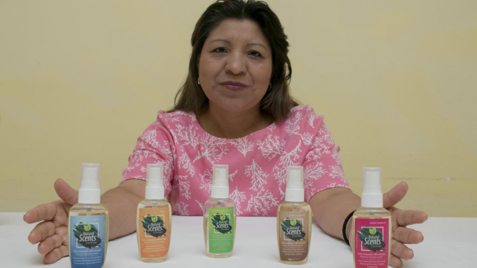 Salvadoran business woman Gloria Hernández shows off her line of massage oils in San José, Costa Rica.