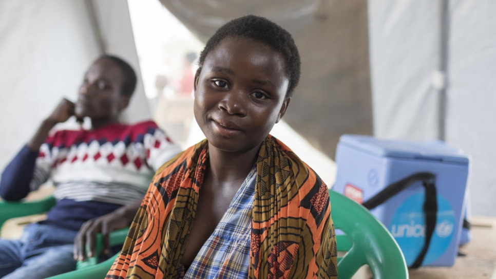 Agnes Manda, 18, a member of the Zambian host community, waits for a check-up at a clinic managed by UNHCR, UNICEF and Médecins Sans Frontières at the Mantapala Settlement.
