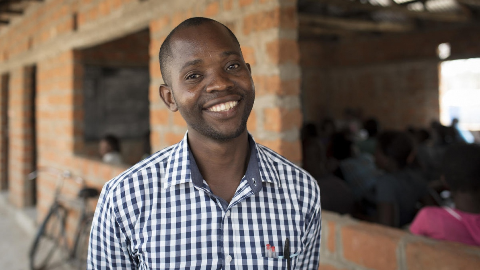 Christopher Mukapa, 30, is headmaster at the school in Mantapala Settlement. He says Zambian students are helping to integrate their Congolese classmates.