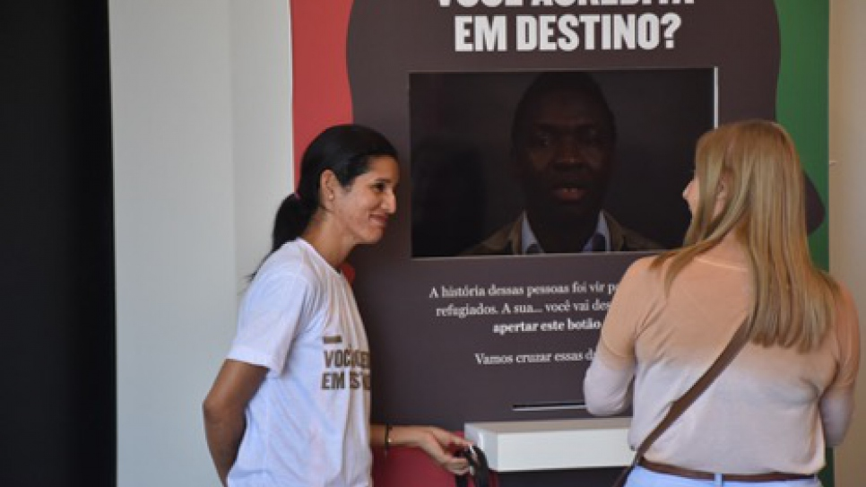 "Francis, from Venezuela, working at an interactive kiosk called ""I Am Refugee,"" during the São Paulo Biennial of Arts."
