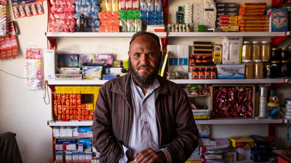 A returned Afghan refugee stands behind the counter at his shop in Dasht-e Tarakhil, Kabul, Afghanistan on November 18, 2018.