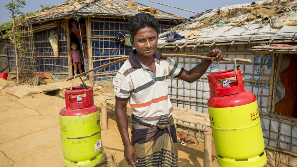 "Azizur Rahman collects LPG refills at a UNHCR distribution centre in Kutupalong Refugee Settlement. ""My children were constantly ill."""