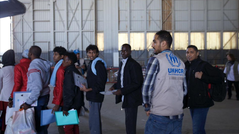 A UNHCR worker supervises the evacuation process at Tripoli airport.