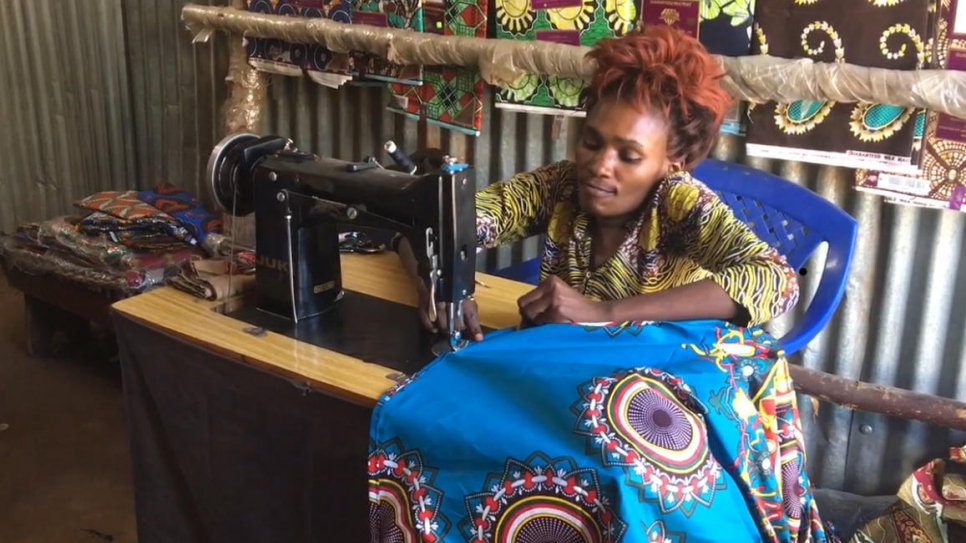 Congolese refugee tailor Hota Biclere sews a dress in her workshop and boutique in Kakuma refugee camp, Kenya.