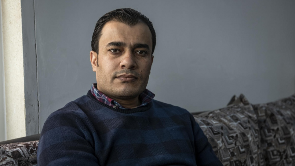 Dr. Mohammed Issa, 33, from Al-Hasakah in northern Syria, relaxes at home in Erbil, capital of the Kurdistan Region of Iraq, after a long day visiting patients.